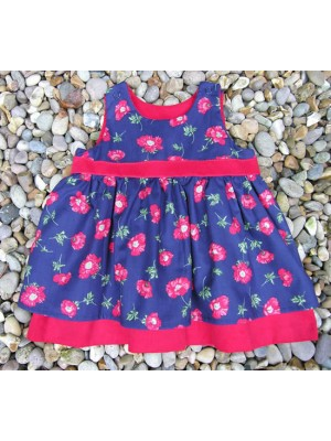 An Isabelle Reversible Pinafore Dress (avail 3m - 8rs)